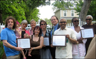 Participating homeowners display their recognition awards