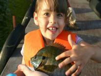 Photo of child holding fish