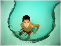photo of boy in swimming pool
